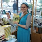 photo of daniella levy in bookstore holding letters to josep